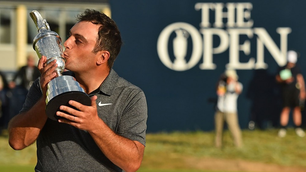 Bogey-free Molinari (69) wins wild Open by two