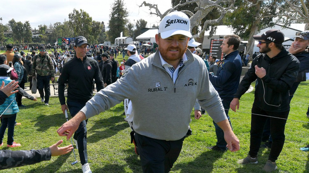Holmes prevails after long, trying Sunday at Genesis Open