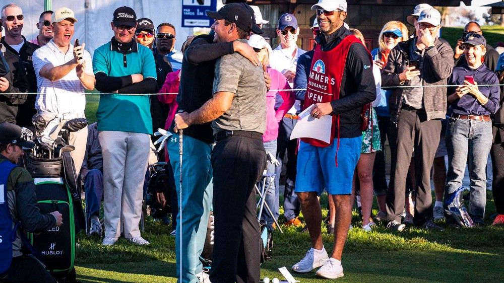 Watch: Spieth, Reed hug it out on first tee at Farmers