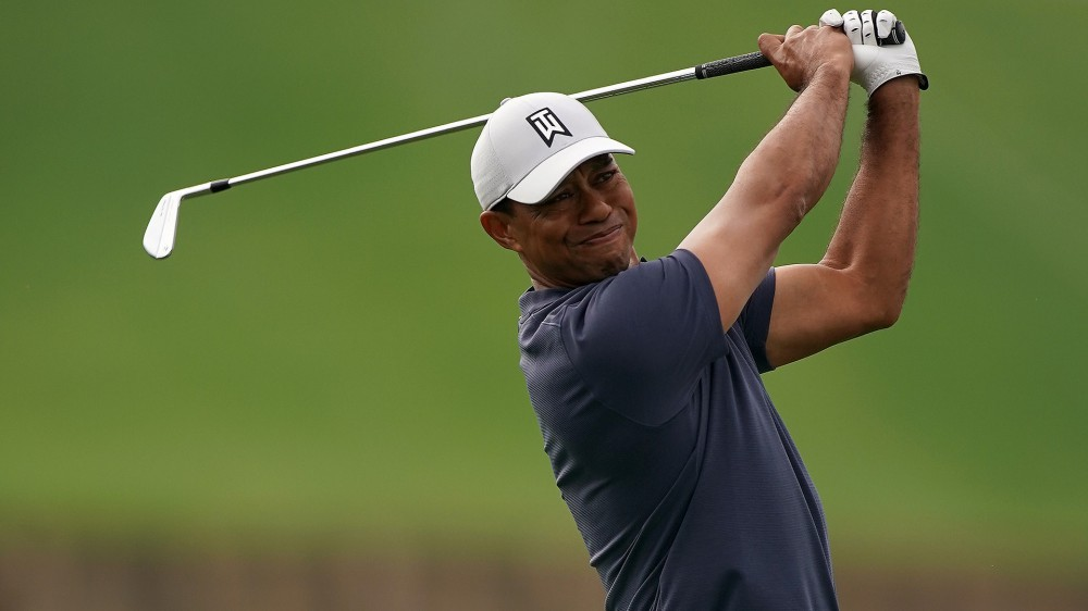 Woods says neck pain a byproduct of back fusion
